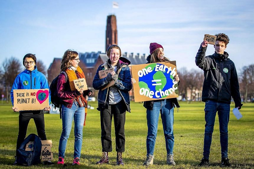 Dutch students at a rally calling for urgent measures to combat climate change during a demonstration in The Hague, the Netherlands.