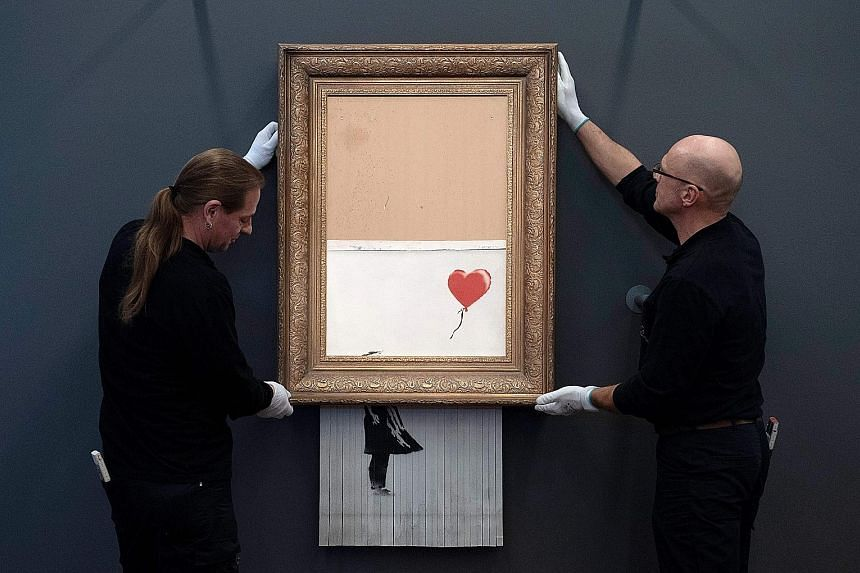 Banksy's painting, Love Is In The Bin, is on loan for a month to the Frieder Burda Museum in Baden-Baden, where the public can view it free of charge.