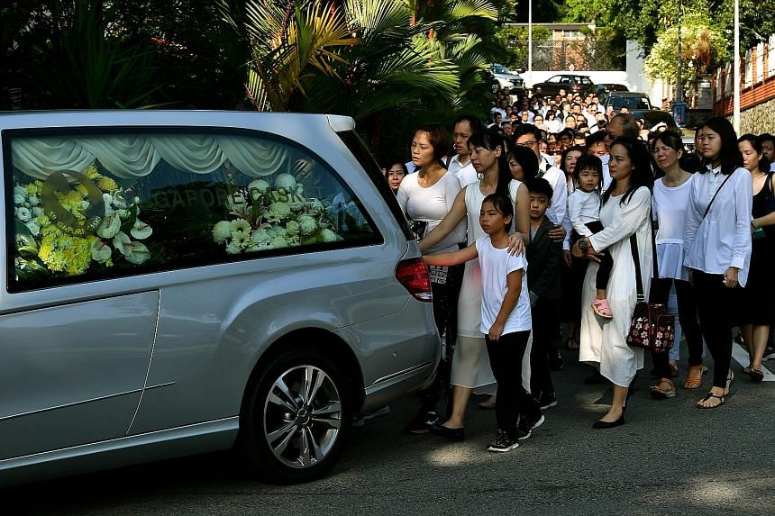 """Mr Ben Goi's hearse leaving for Mandai Crematorium yesterday. His father, Mr Sam Goi, said in his eulogy at Mandai: """"I hope my youngest son can have a happy life in heaven as he did in life. I must thank everyone for coming to my place and sending hi"""