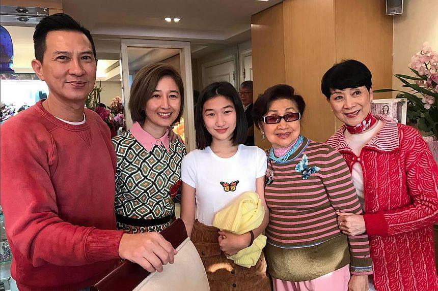 STAR-STUDDED NEW YEAR: In a rare photo of Hong Kong actor-director Nick Cheung and his family, he is seen with (from left) his wife, actress Esther Kwan, their daughter Brittany, Cantonese opera actress Bak Sheut Sin and veteran actress Connie Chan.