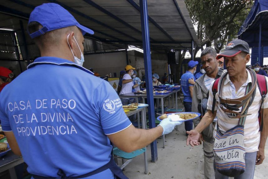 Venezuelan migrants are served a meal at the Divina Providencia migrant shelter in Cucuta, Colombia, on the border with Venezuela, on Feb 7, 2019.