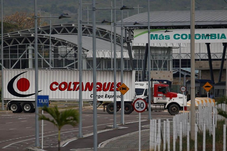 A truck arrives at a warehouse, where international humanitarian aid for Venezuela will be stored according to authorities, near the Tienditas cross-border bridge between Colombia and Venezuela, on Feb 7, 2019.