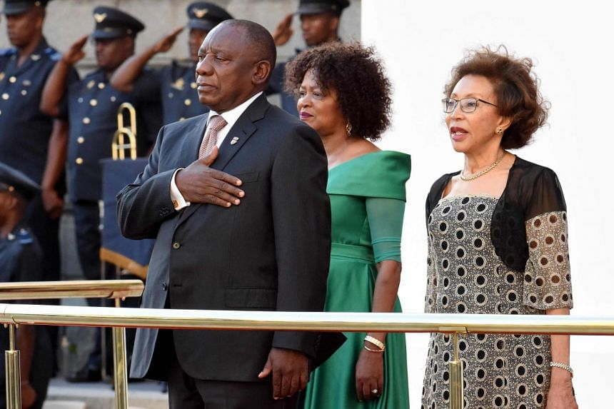 Ramaphosa (left), First Lady Tshepo Motsepe (right) and speaker of the national assembly, Baleka Mbete (centre, back), arrive for the annual State of the Nation address.