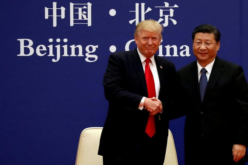 US President Donald Trump and China's President Xi Jinping meet business leaders in Beijing, China, on Nov 9, 2017.