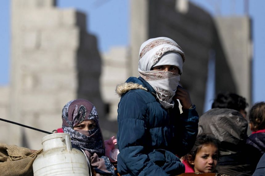 Syrian people return to their homes in Hajin after the area was freed from ISIS on Feb 2, 2019.
