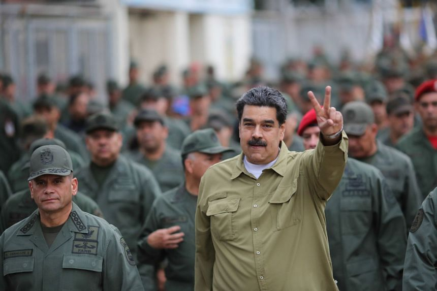 Maduro gestures during a meeting with soldiers at a military base in Caracas on Jan 30, 2019.