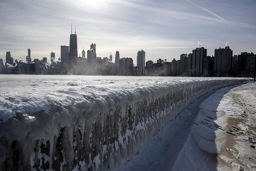 Lake Michigan frozen over last week in Chicago, Illinois. Tens of millions of Americans braved Arctic-like temperatures as low as minus 49 deg C, which paralysed the US Midwest.