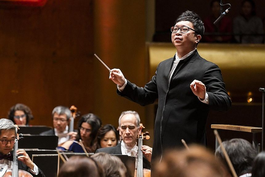 Wong Kah Chun conducting the New York Philharmonic during a Chinese New Year concert at the David Geffen Hall on Wednesday.