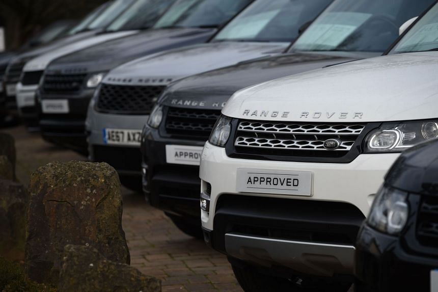 Jaguar Land Rover posts quarterly loss and takes £3.1bn hit