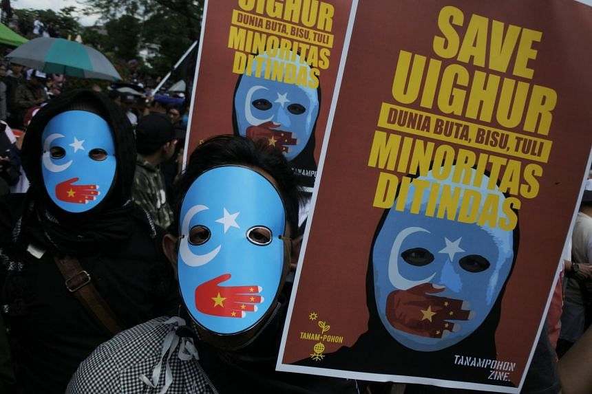 People protest against the treatment of Uighur Muslims by the Chinese government, in Bandung, Indonesia.