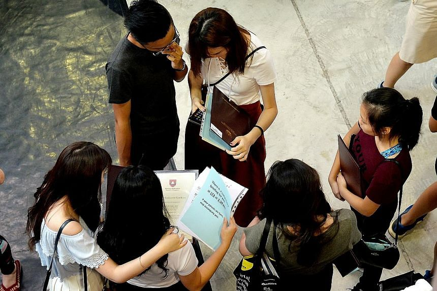 Students checking their A-level result slips last year in Nanyang Junior College, one of the four schools affected by the theft of exam scripts for Chemistry Paper 3 in 2017. The scripts were being delivered to an examiner in Britain in November that
