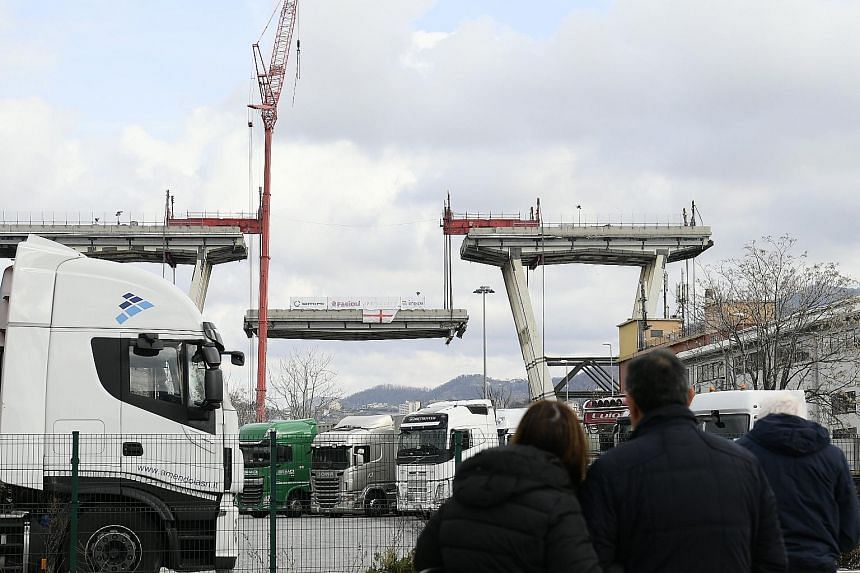 Demolition works at Morandi motorway bridge in the Italian port city of Genoa yesterday. Part of the bridge collapsed during a storm last August, killing 43 people.