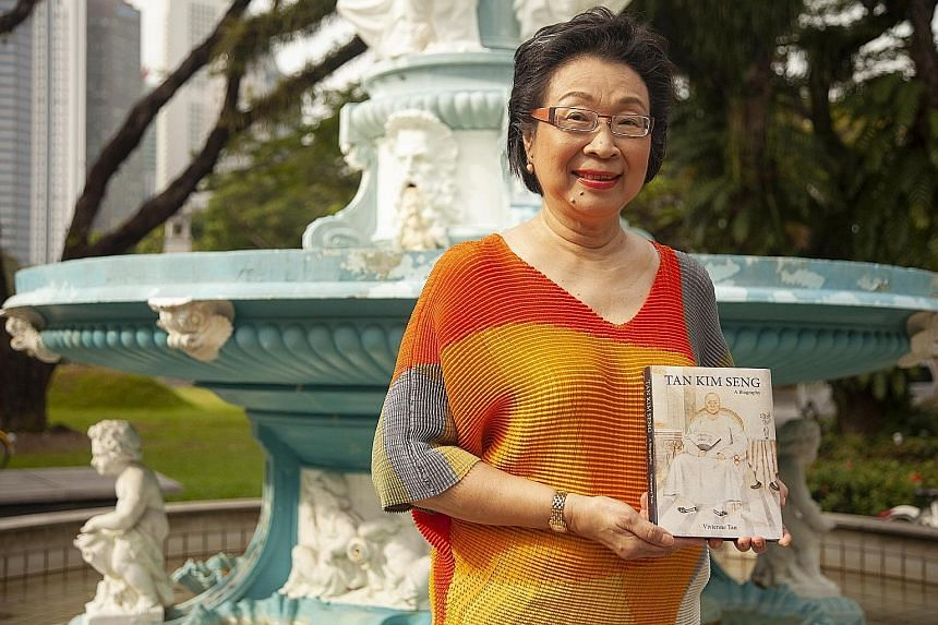 Above: First-time author Vivienne Tan at the Tan Kim Seng Fountain with her book on her husband's ancestor.