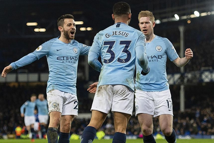 Kevin de Bruyne (right) and Bernardo Silva (left) congratulating Gabriel Jesus for scoring Manchester City's second goal in their 2-0 win over Everton on Wednesday. De Bruyne is not guaranteed a start against Chelsea today.