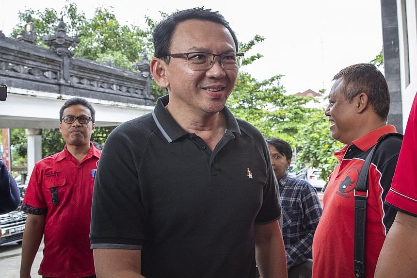 Former Jakarta governor Basuki Tjahaja Purnama, who was released from jail recently, visiting the office of Indonesian Democratic Party of Struggle (PDI-P) in Bali on Friday. He joins the political party of President Joko Widodo just before the April