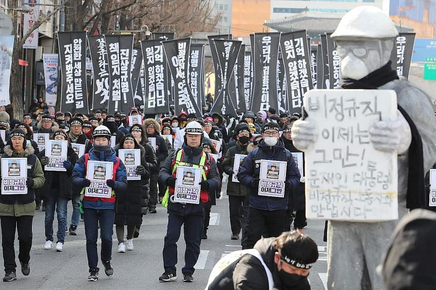 Some 2,500 South Koreans marching through Seoul to honour Mr Kim Yong-kyun, 24, who died last month after being sucked into a coal conveyor belt. He was working as a contractor at a power plant 110km south of Seoul.