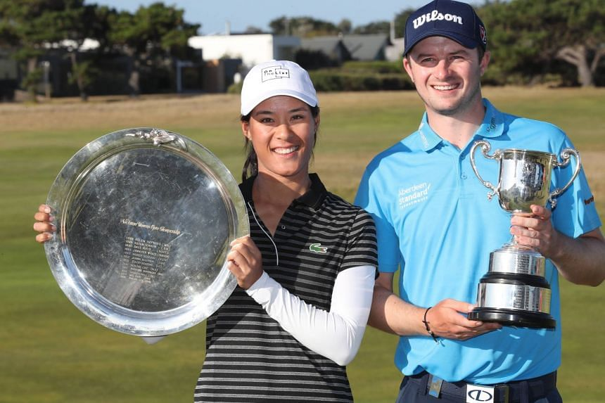Celine Boutier of France and David Law of Scotland with their trophies after winning respectively the women's and men's Victorian Open at 13th Beach Golf Links in Melbourne, Australia on Feb 10, 2019.