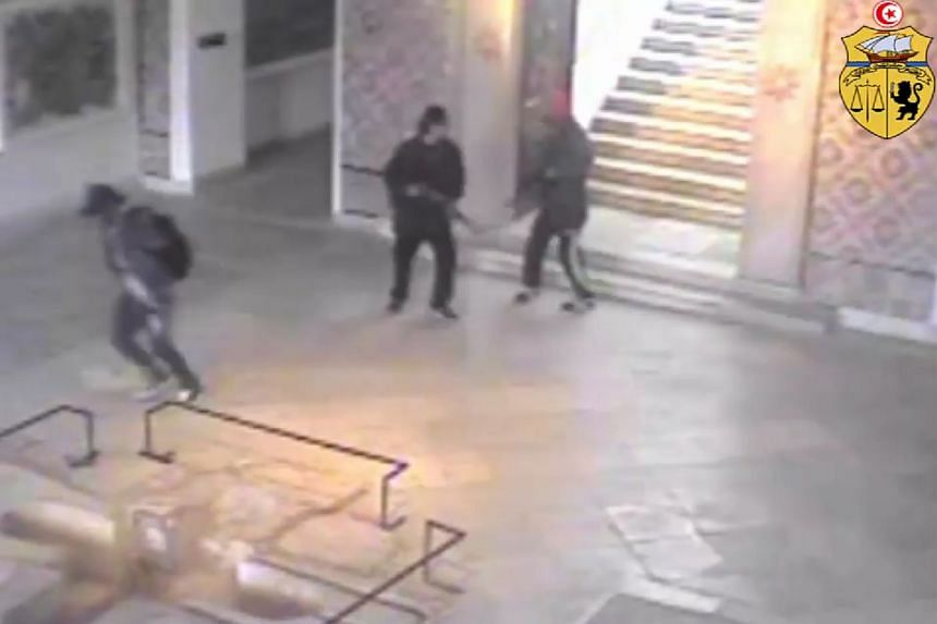 A CCTV image in 2015 reportedly shows the two gunmen (right) who attacked Tunisia's Bardo museum.