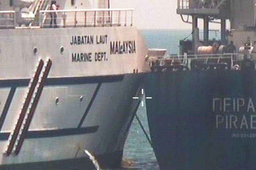 The accident happened at about 2.30pm on Feb 9, when Pireas (right) was on its way to its next port of call at Tanjung Pelapas in Johor when it collided with Polaris, which was anchored.