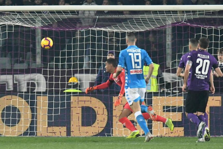 Fiorentina goalkeeper Alban Lafont (in red) going for the ball during the Serie A football match against Napoli on Feb 9, 2019.