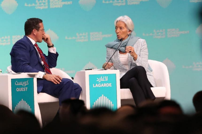 Christine Lagarde (right) , managing director and chairwoman of the International Monetary Fund, speaks to journalist Richard Quest, during the opening session of the World Government Summit in Dubai, on Feb 10, 2019.
