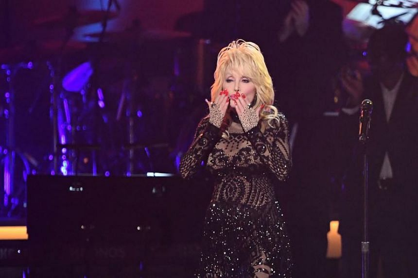 Singer Dolly Parton blowing a kiss after performing at the 2019 MusiCares Person of the Year gala in Los Angeles on Feb 8, 2019.
