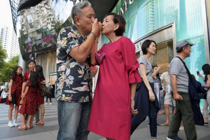 """Mr Harold Quay and his wife Ivy """"freezing"""" outside ION Orchard to mark World Marriage Day on Feb 10, 2019."""