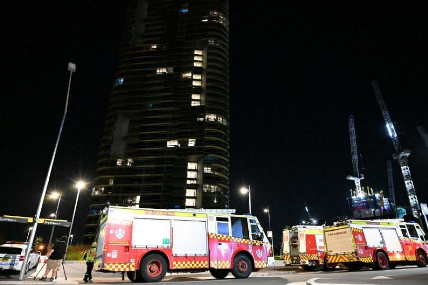 Fire trucks are seen in front of the 38-storey Opal Tower in Sydney, after residents said they heard cracking noises, on Dec 25, 2018.