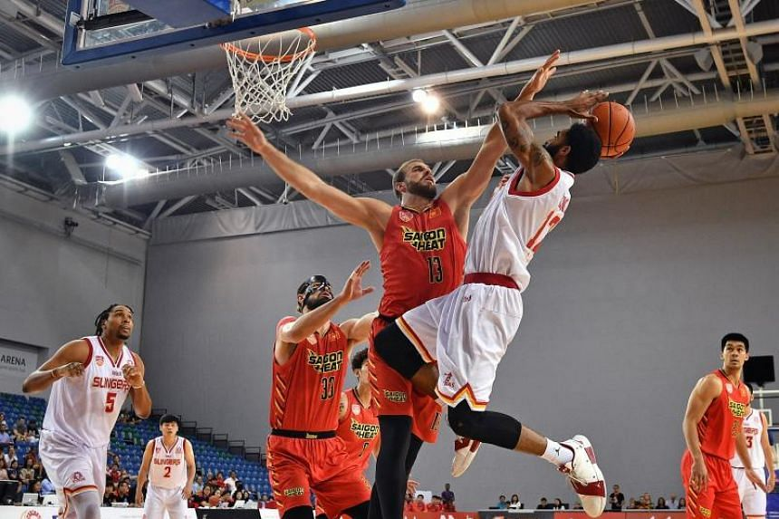 Saigon Heat's Murphy Burnatowski (centre, no.13) blocks Singapore Slingers' Jerran Young in the Asean Basketball League match between the Singapore Slingers and Saigon Heat at OCBC Arena on Feb 10, 2019.