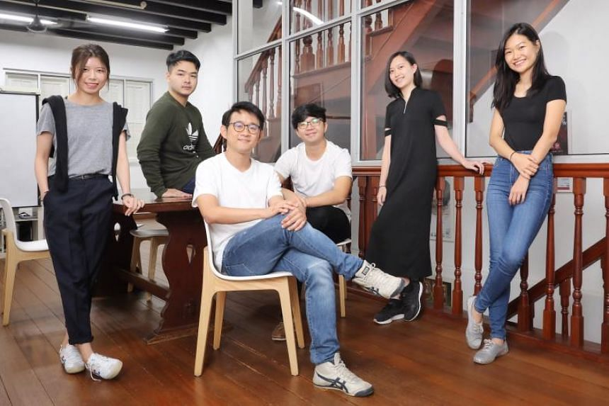 The Transition Room writer and director Stanley Seah (seated, front), together with (from left) set and costume designer Vivien Lau, lighting designer Tai Zi Feng, sound designer Vick Low, stage manager Jovy Tan and actress Tan Hui Er.
