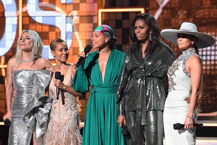 Former US first lady Michelle Obama (second, right) made a surprise appearance on the Grammys stage alongside superstars (from left) Lady Gaga, actress Jada Pinkett-Smith, host Alicia Keys and singer Jennifer Lopez.