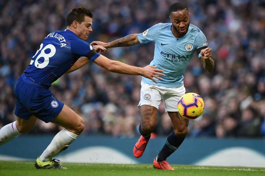 Chelsea's Spanish defender Cesar Azpilicueta (left) vies with Manchester City's English midfielder Raheem Sterling at the Etihad Stadium in Manchester, north west England, on Feb 10, 2019.