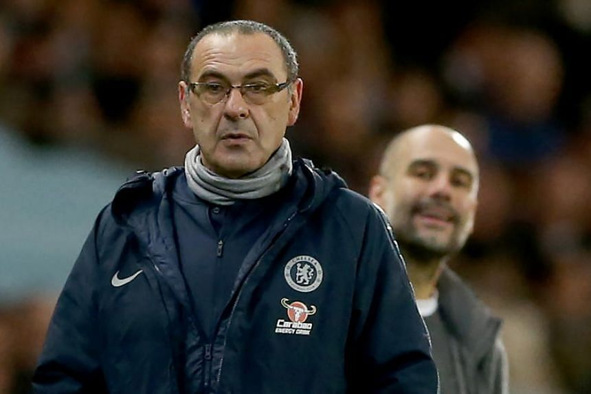 Chelsea's manager Maurizio Sarri (left) and Manchester City's manager Pep Guardiola during the EPL match between Manchester City and Chelsea at the Etihad Stadium in Manchester, Britain, on Feb 10, 2019.