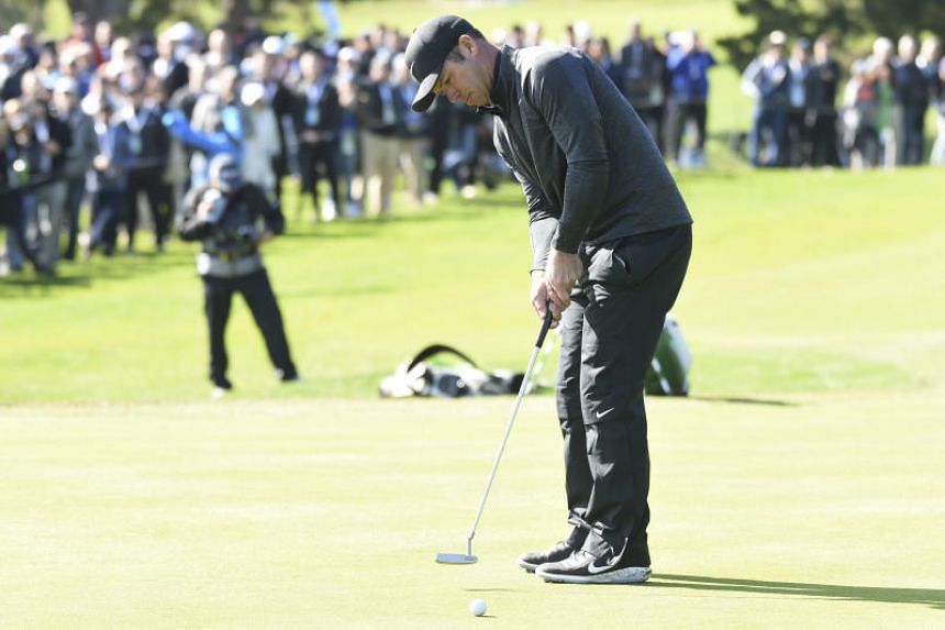 Paul Casey putts on the first hole during the final round of the AT&T Pebble Beach Pro-Am golf tournament at Pebble Beach Golf Links.