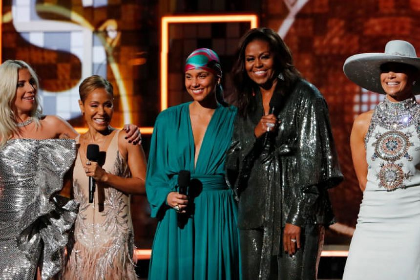 Singer and songwriter Alicia Keys surprised many when she invited her powerful posse of friends on stage - (from left) Lady Gaga, Jada Pinkett Smith, Alicia Keys, former US First Lady Michelle Obama, and actress-singers Jennifer Lopez.