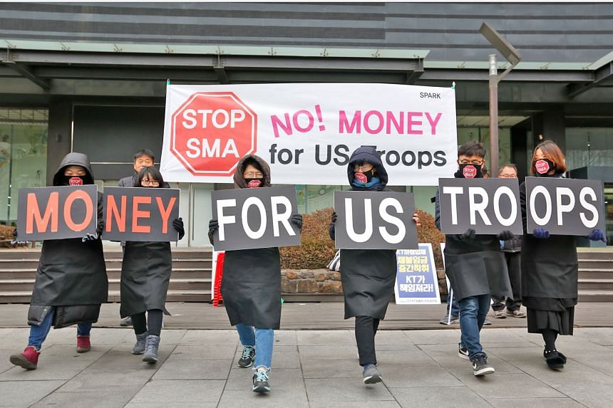 South Korean protesters at a rally against the Special Measures Agreement (SMA) between Washington and Seoul, near the US Embassy in the South Korean capital on Jan 31. The new deal must still be approved by South Korea's Parliament, but  it would