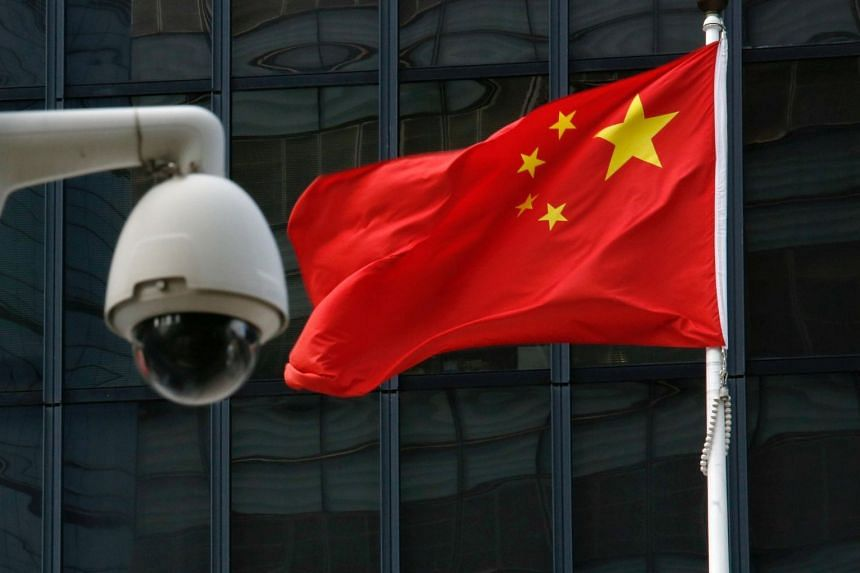 The Chinese national flag flies behind security cameras outside the government headquarters in Hong Kong, China on Nov 22, 2017.