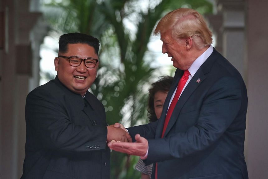 North Korean leader Kim Jong Un and US President Donald Trump shaking hands at the start of their historic summit meeting at the Capella Singapore hotel on Sentosa on Jun 12, 2018.