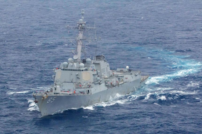 An official said the two US guided-missile destroyers traveled within 12 nautical miles of Mischief Reef in the disputed Spratly Islands.