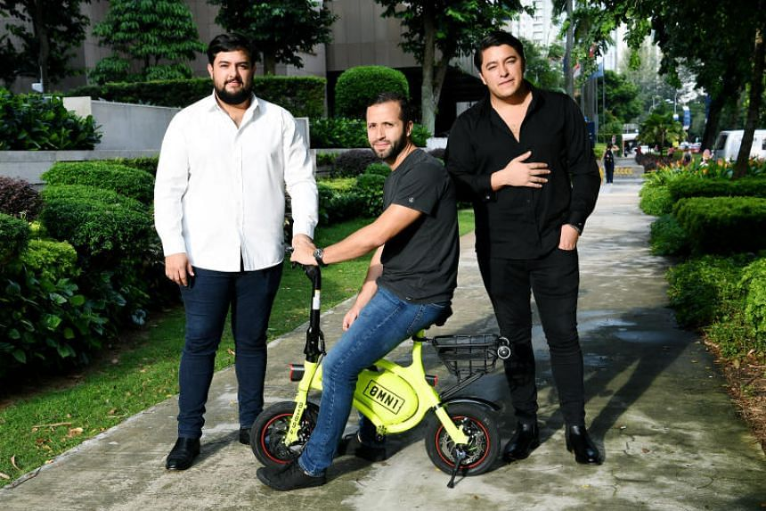 Omni Sharing directors Oscar Moises Chaves (left) and his brother Samuel (right), with chief operating officer Carlos Abarca. Mr Oscar Moises Chaves is the head of investment firm OSS Inversiones, which bought oBike in September 2018.
