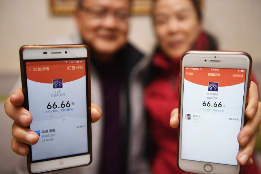 """China has rapidly embraced a cashless society in which payments are made via smartphone apps, and electronic """"red packets"""" have become hugely popular."""
