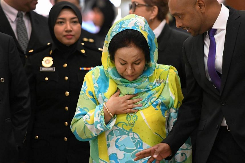 Rosmah Mansor, wife of former Malaysian prime minister Najib Razak, being escorted by police personnel during her arrival at court in Kuala Lumpur on Nov 15, 2018.