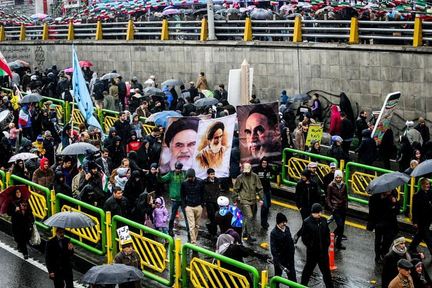 Soldiers, students, clerics and black-clad women holding small children thronged streets across Iran, many with portraits of Ayatollah Ruhollah Khomeini.