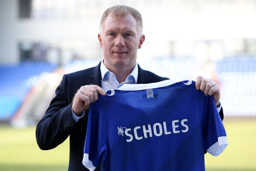 England's former player Paul Scholes holds his new team's jersey after his press conference announcing him as the new manager of English League Two side Oldham Athletic at Boundary Park, on Feb 11, 2019.