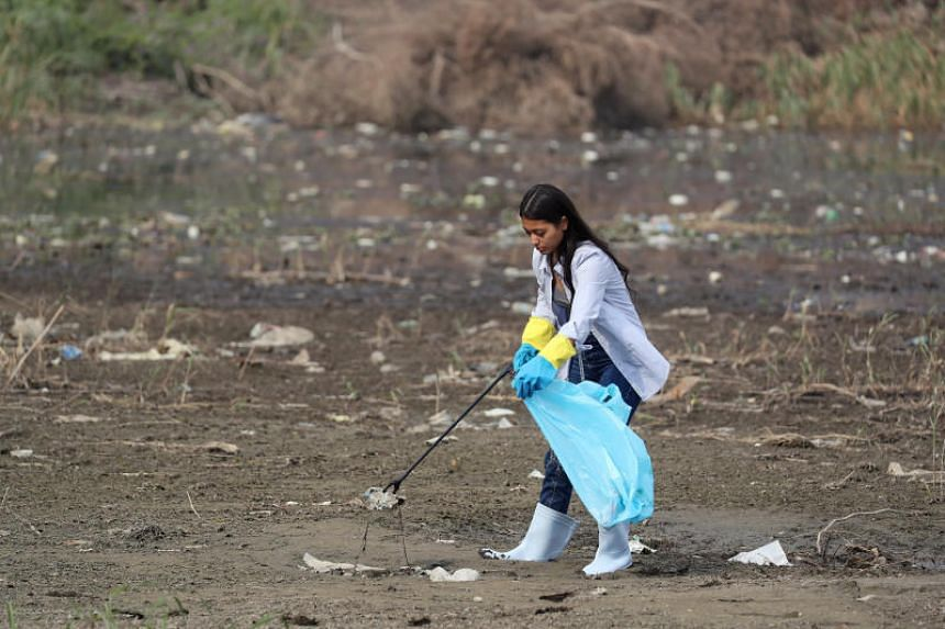 Actor Mai El Gheity collects waste and plastic as part of a campaign to clean up the Nile River in Cairo, Egypt, on Feb 11, 2019.