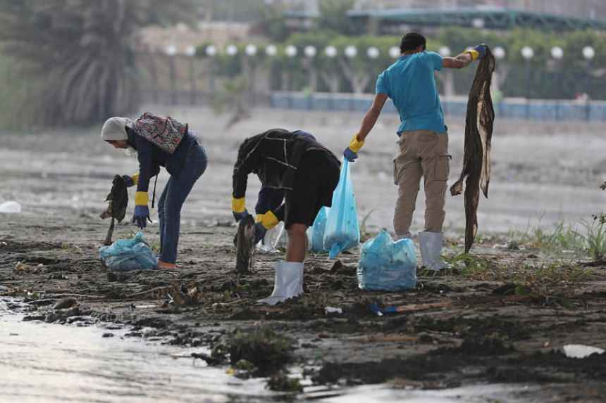 Egyptian youth volunteers collect waste and plastic as part of a campaign to clean up the Nile River in Cairo, Egypt, on Feb 10, 2019.