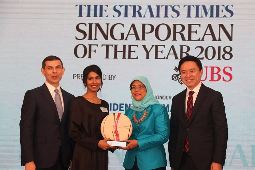 President Halimah Yacob presenting the award to Singaporean of the Year winner Siti Noor Mastura. The Straits Times editor Warren Fernandez (extreme left) and Mr Edmund Koh, President UBS Asia Pacific, were also at the event.