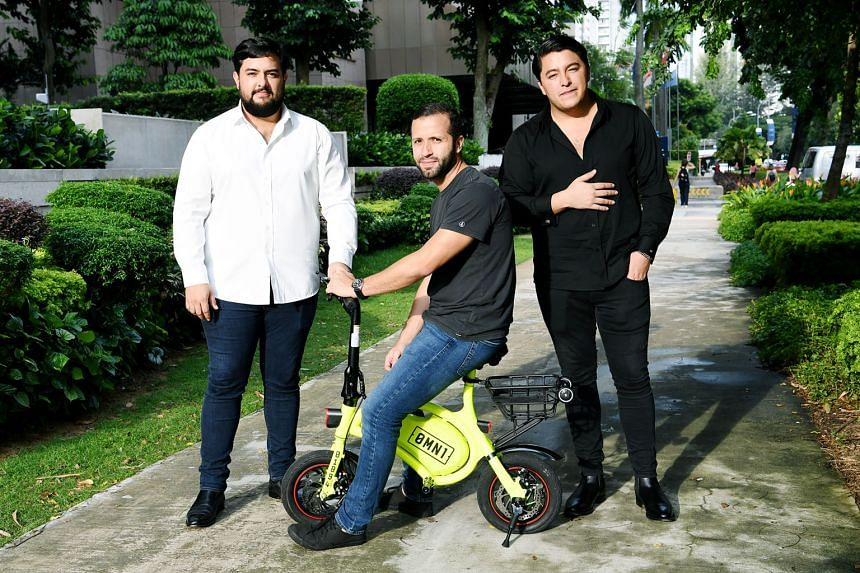 Omni Sharing directors Oscar Moises Chaves (left) and his brother Samuel (right), with chief operating officer Carlos Abarca. Omni yesterday applied for a sandbox licence to rent out 500 e-scooters here under the 0mn1 brand.
