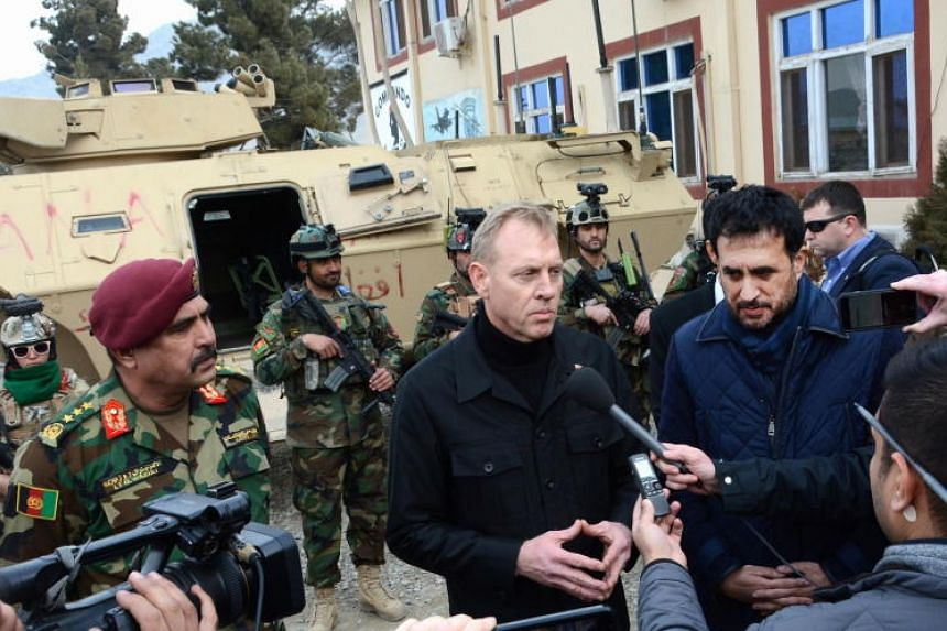 Acting defense minister of Afghanistan, Asadullah Khalid (right) and Acting US secretary of Defense Patrick M. Shanahan (second right) visiting Afghan special force unit in the outskirt of Kabul, Afghanistan, on Feb 11, 2019.