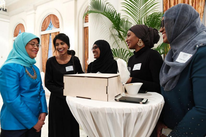 (From left) President Halimah Yacob with Singaporean of the Year winner Siti Noor Mastura, her mother Mdm Maimuna Majeed, and her sisters Siti Noor Zahiraa and Siti Noor Baizura.